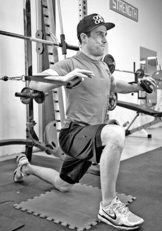 Tim Shantz demonstrates a chest press on one knee to engage lower body and core to fight gravity during the exercise.