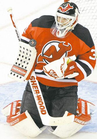 FULL CLOSECUT CLOSE CUT New Jersey Devils goaltender Martin Brodeur makes a save during the second period of an NHL hockey game against the New York Rangers Tuesday, March 6, 2012, in Newark, N.J. The Devils defeated the Rangers 4-1. (AP Photo/Bill Kostroun)