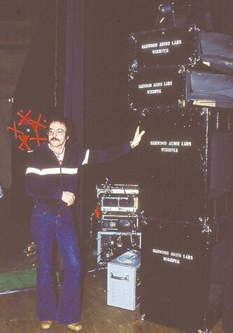 Gerry Leger standing by the Oakwood Audio speakers on a Bobby Vinton tour.
