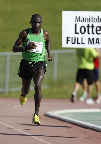 2012 Mens full marathon winner, Thomas Omwega, nears the finish line at the University of Manitoba.