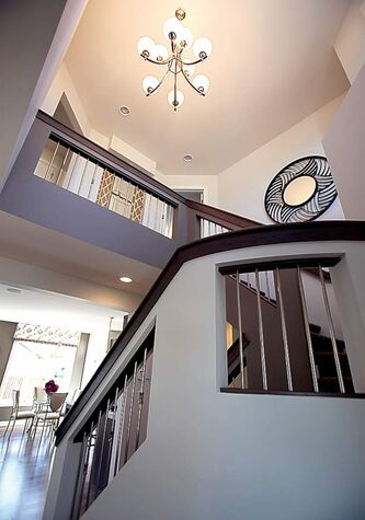 The staircases are located in the turret at the front of the house, opening up space elsewhere.