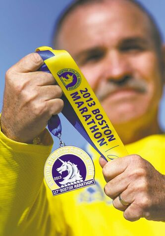 Bob Conarroe with his 2013 Boston Marathon medal.