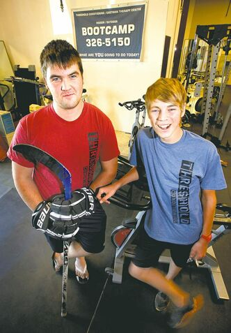 Taylor Plett (left) and Roger Thiessen are both 15, but they will react differently to training stress because of their dissimilar body types.