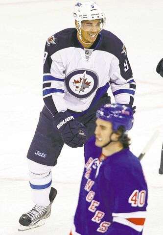 Evander Kane celebrates his second-period goal Tuesday night.