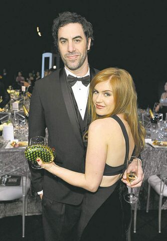 Sacha Baron Cohen, left, and Isla Fisher pose in the audience at the 19th Annual Screen Actors Guild Awards at the Shrine Auditorium in Los Angeles on Sunday Jan. 27, 2013. (Photo by John Shearer/Invision/AP)