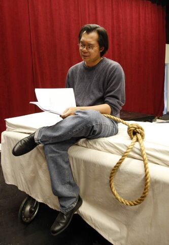 Playwright Joseph Aragon hangs around set.
