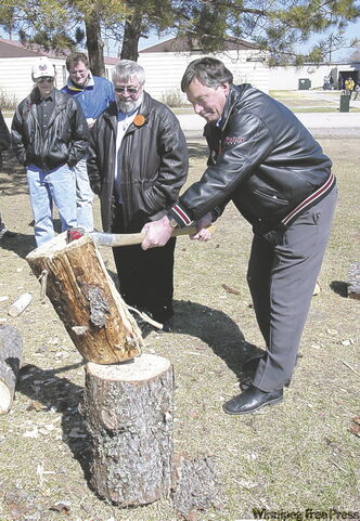 Gary Doer persists in his attempt at splitting wood for a sacred fire.