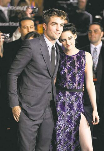 Robert Pattinson, left, and Kristen Stewart arrive at the world premiere of