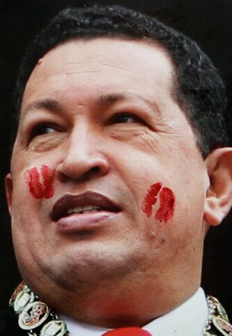 FILE - In this March 19, 2013 file photo, kiss marks left by supporters of Venezuela's former President Hugo Chavez cover a photograph of him hanging on a wall during the annual book fair in Caracas, Venezuela. For his loyal followers, Chavez was already a living legend on par with independence era hero Simon Bolivar even before his March 5 death from cancer. In a mere three weeks, however, Chavez has ascended to divine status, at least according to political rhetoric, as the government and his die-hard loyalists build a religious mythology around him ahead of April 14 elections scheduled to pick a new leader. (AP Photo/Fernando Llano, File)