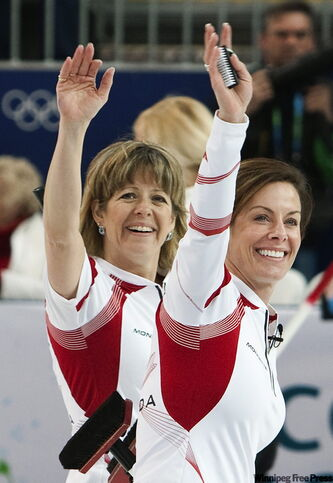 Canada second Carolyn Darbyshire (left) and skip Cheryl Bernard acknowledge the roars after thumping Sweden on Monday.