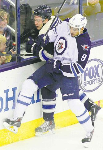Evander Kane -- seen checking Jackets defenceman Jack Johnson  -- was a force in his return Monday.