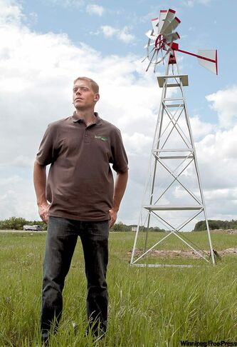 RICHER, MB (June 15, 2010) - Tony Gibson, 31, on the edge of his development project, EcoVillage Resort Camping. The windmill pictured here is designed to aerate a small lake created at the resort's entrance. All infrastructure will be powered by solar and wind power. (Janek Lowe/Winnipeg Free Press)