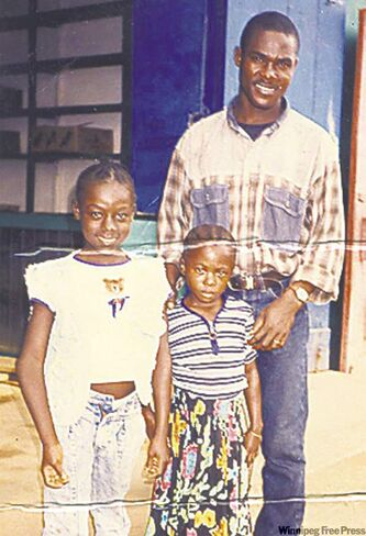 Victor Kossigbo with Viola, 15, and Victoria, 12, at the Buduburan refugee camp in Ghana in 1998.