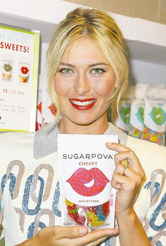 This image released by Starpix shows tennis player Maria Sharapova at a launch for her premium collection of candy called Sugarpova at Henri Bendel department store on Monday, Aug. 20, 2012 in New York. (AP Photo/Starpix, Amanda Schwab)