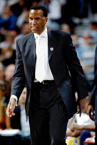 Denver Nuggets assistant coach Adrian Dantley directs his team against the New Orleans Hornets in the first quarter of an NBA basketball game in Denver on Thursday, March 18, 2010. Dantley was filling in for head coach George Karl, who is suffering from neck and throat cancer and is under treatment. (AP Photo/David Zalubowski)