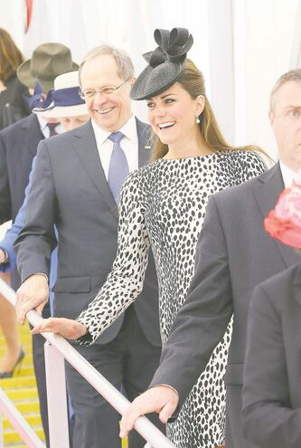 President and CEO of Princess Cruises Alan Buckelew (L) escorts Catherine, Duchess of Cambridge as she walks down the gangplank of the Royal Princess.