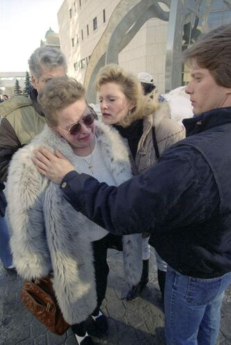 Kelly Lynn Stewner's mother, Alice Cardinal, is comforted by Deb Peary, sister of the victim, in 1995.