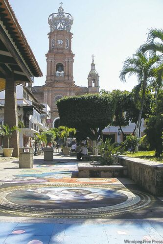 Chalk murals line the town square near Puerto Vallarta's famous cathedral.