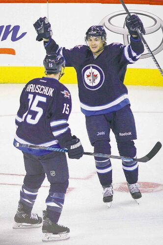 Jets Michael Frolik with Matt Halishchuk. Frolik and Pavelec will be on the Czech Republic Olympic team.