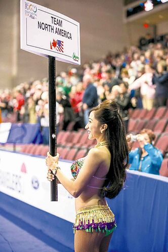 What would a sporting event in Vegas be without the sign girls?