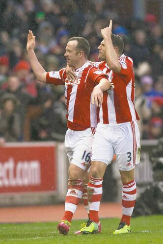 Stoke's Charlie Adam (left) celebrates with Erik Pieters after Adam's second netter against Manchester United at Britannia Stadium Saturday.