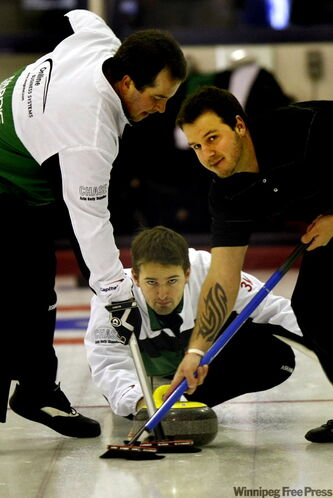 Reid Carruthers peers through his sweepers Thursday at Elmwood Curling Club, where he beat Rob Cosens in zone playdowns.