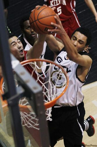 Kelvin's Marco Valera (left) and Garden City's Andre Arruda-Welch fight for the rebound during the Wesmen Classic high school final on Friday.