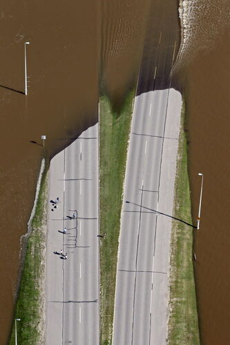 Floodwaters from the Assiniboine River flow over a roadway in Brandon last week.