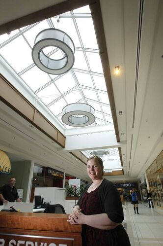 Carleen McDowell, an administrative assistant with 20 Vic Management Inc., stands under the new skylights and LED lighting in St. Vital Centre that helped the mall win a BOMA BEST Award of Excellence for energy-efficiency improvement.