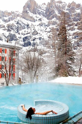 Relax and enjoy one of Switzerland's great natural resources -- its waters -- at the outdoor pool at Hotel Les Sources des Alpes in Leukerbad.