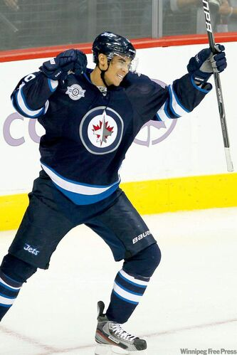 Winnipeg Jets forward Evander Kane celebrates his goal against the Carolina Hurricanes at the MTS Centre on Saturday. Rumours he wants to be traded are false, his agent says.