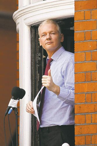 Julian Assange speaks Sunday from a window of the  Ecuadorean Embassy in London.