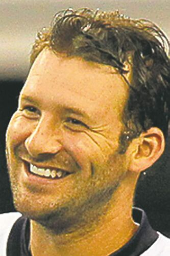 Dallas Cowboys quarterback Tony Romo (9) smiles during stretching exercises during the team's Silver & Blue Debut at Cowboys Stadium in Arlington, Texas, on Thursday, August 23, 2012. (John Rhodes/Fort Worth Star-Telegram/MCT)