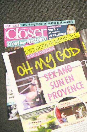 Photos of a topless Kate appear on the front cover of French gossip magazine Closer. The photos have outraged both the royal couple and Britons in general.