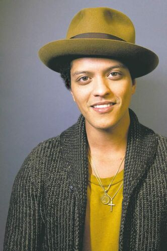 "American singer-songwriter and record producer Bruno Mars, born Peter Gene Hernandez, poses for a portrait on Monday, Nov. 5, 2012 in New York. Mars' recent appearance on �Saturday Night Live� was more like Saturday Night Fever: He says he had so much fun hosting the show that he'd be happy to do it again. ""Whatever 'SNL' wants from me, they can always call me,� the smiling 27-year-old said in an interview Wednesday afternoon. �I don't know who told them I can act or anything 'cause I can't. I don't know what they saw. (But) whatever they need from me, they can get."" (Photo by Dan Hallman/Invision/AP)"