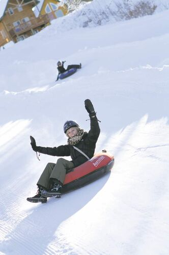 Lindsey Egan has a blast flying down one of the resort's tubing runs. The resort added four more tubing runs this year to total eight slides.