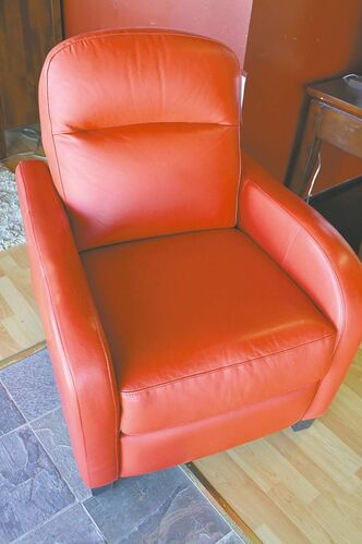 Red leather reclining chair by Sklar Peppler. Available in other colours; frame solid hardwood with dowels.