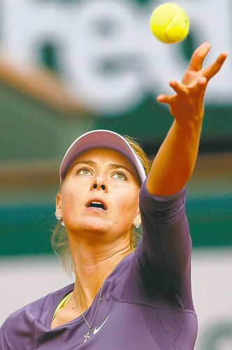 Maria Sharapova serves against Eugenie Bouchard. Sharapova was leading when rain halted play.
