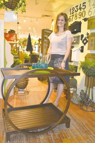 Julie Garcia, owner of The Garden Room, with aluminum tea cart, $695.
