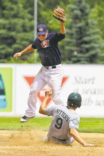 Winnipeg Goldeyes' Amos Ramon can't quite get his foot down on the bag in time to get Gary's Christian Vitters.