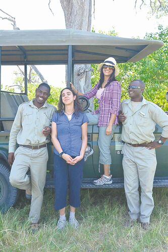 From left, safari guide Kutlwano Mobe, safari guests Patricia Lawton and Noronha, and another guide, Kgosikebatho Marota, in Botswana's Okavango Delta.