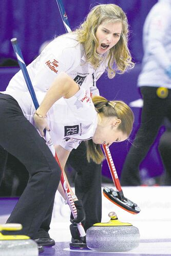 Jennifer Jones (above) directs the brushing of third Kaitlyn Lawes during a 6-5 victory over Heather Nedohin Thursday afternoon.