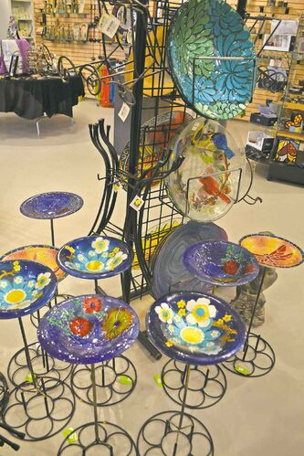 Birdbaths available from Lacoste Garden Centre come in a variety of bright colours and unusual designs.