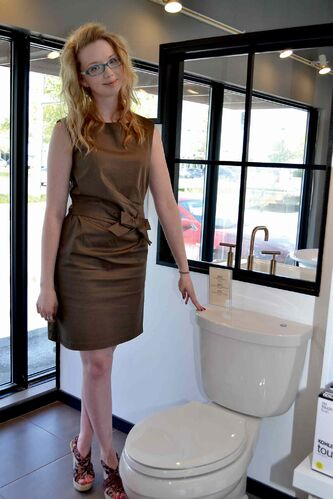 Sales consultant Kyla Hazen with a touch-sensitve dual flush toilet in the Robinson Bath Centre showroom on Ellice.