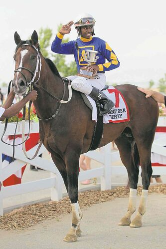 Jalon Samuel waves from the winner�s circle after riding Street Prancer to the The Manitoba Derby title.