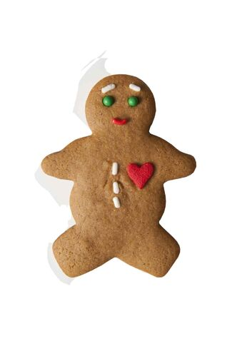 The holidays bring out the baker in many as traditional holiday cookies, such as these classic mini-gingerbread men cookies with decorations, are made for parties and gifts.