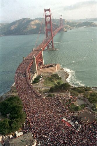 File - In this May 24, 1987 file photo, a crowd estimated at several hundred thousand jams the deck of the Golden Gate Bridge in San Francisco during a walk to celebrate the 50th anniversary of the bridge. The bridge was heralded as an engineering marvel when it opened in 1937. It was the world's longest suspension span and had been built across a strait that critics said was too treacherous to be bridged. But as the iconic span approaches its 75th anniversary, the engineers who have overseen it all these years say keeping it up and open has been a feat unto itself. (AP Photo/Doug Atkins, File)