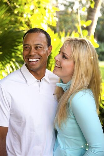 In this 2013 photo provided by Tiger Woods and Lindsey Vonn, golfer Tiger Woods and skier Lindsey Vonn pose for a portrait. Two months after rumors began circulating in Europe, Woods and Vonn posted separate items on their Facebook pages Monday, March 18, 2013, to announce their relationship. (AP Photo/Courtesy Tiger Woods/Lindsey Vonn) MANDATORY CREDIT TO COURTESY TIGER WOODS/LINDSEY VONN