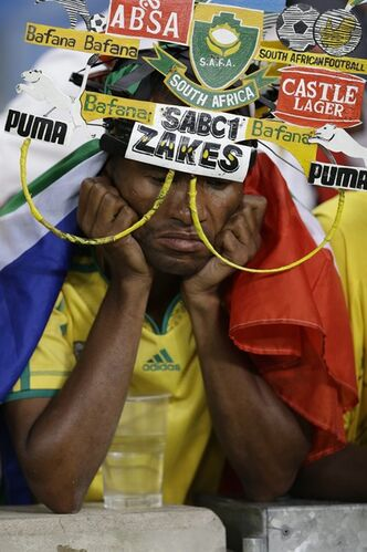 A South Africa fan reacts as his team is knocked out of the African Cup of Nations after losing to Mali on penalties in their quarterfinal soccer match, at Moses Mabhida Stadium in Durban, South Africa, Saturday, Feb. 2, 2013. (AP Photo/Rebecca Blackwell)