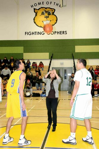 Coun. Devi Sharma (Old Kildonan) throws the opening tip at the Philippine Basketball Association's 2013 opening day ceremonies.